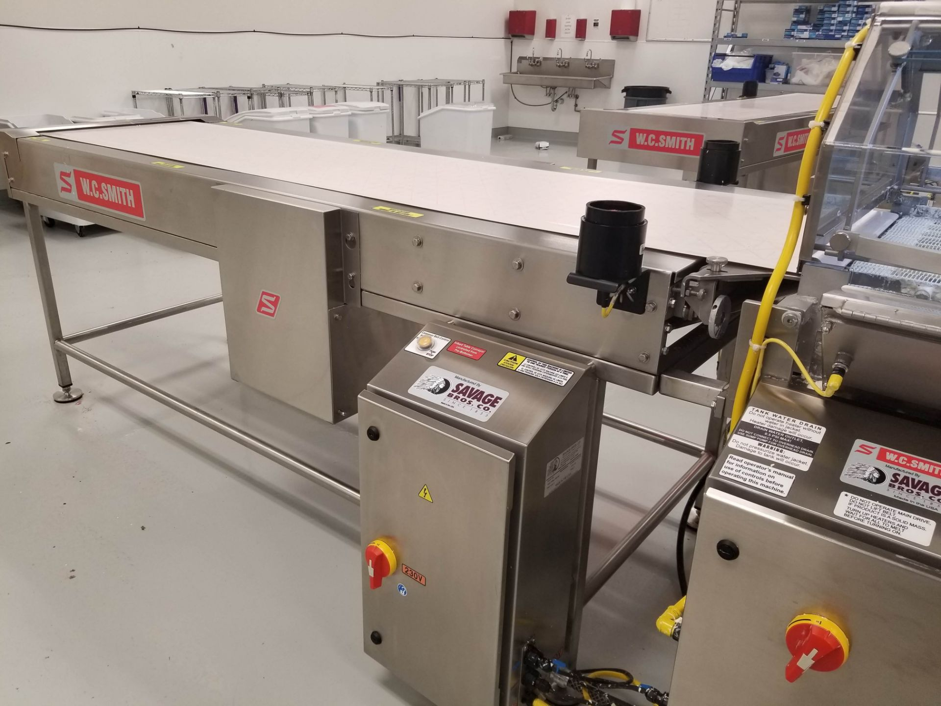"Lot 21 - Smith 24"" Stainless Steel Enrobing line – New 2017 - Smith model 5224-49 8-ft long Stainless Steel"