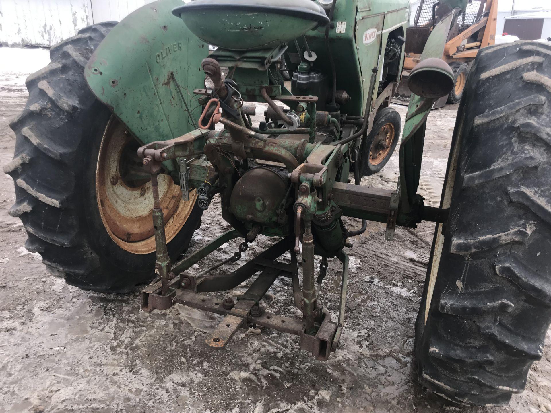 Lot 29 - Mdl.770 Gas S#61-728-721, NF, Factory 2pt/3pt Hitch, Fenders, 13.6x38 (good rubber) Orginal