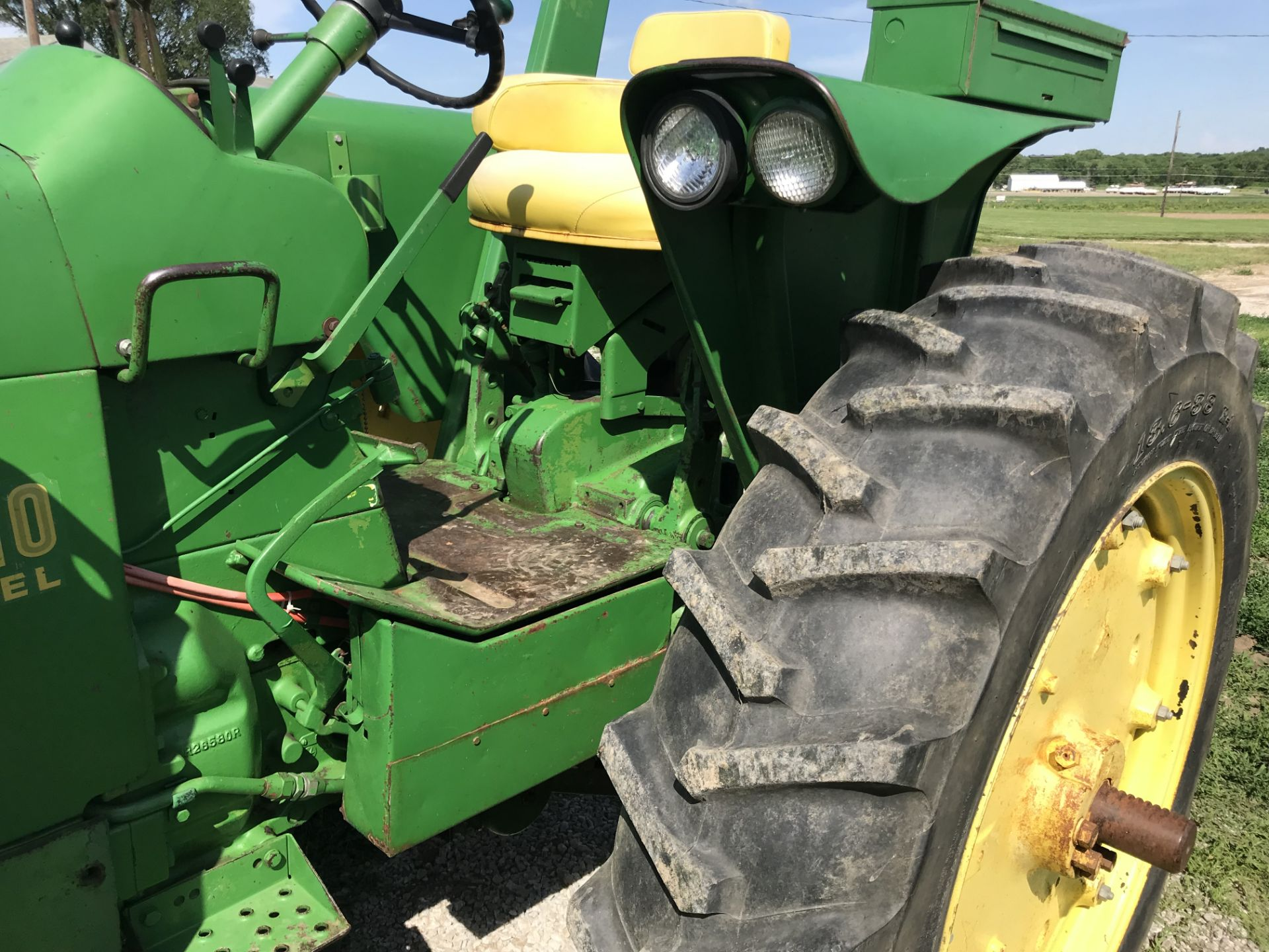 Lot 17 - JD 3010 Diesel S#8945, WF, 1 Remote, ROPS, New 13.6x38 Tach shows 4550hrs, (loader sold separately)