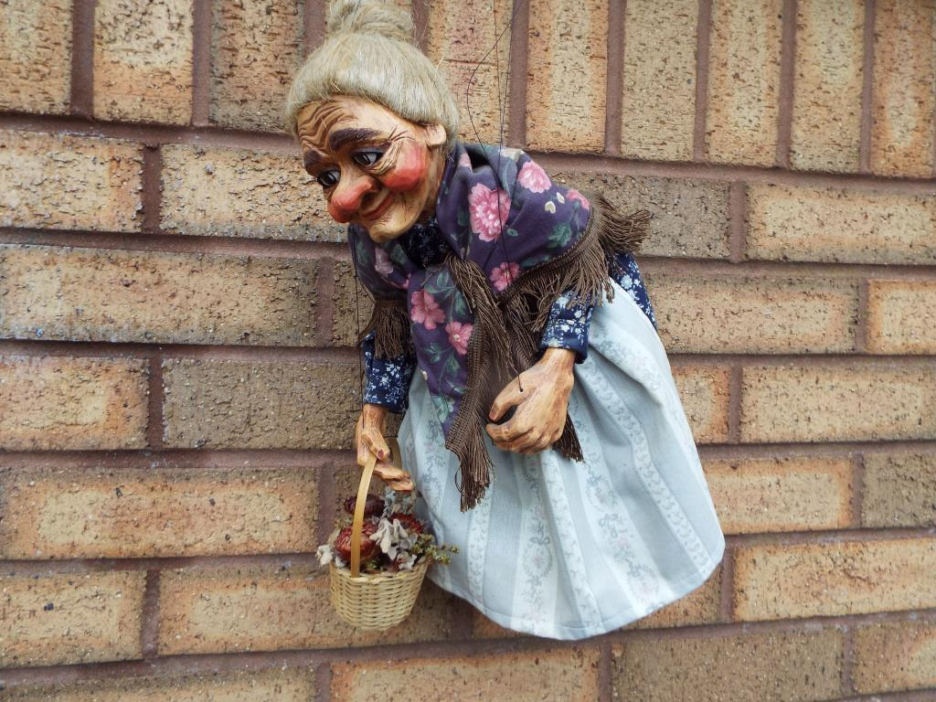 Lot 51 - A marionette in the form of an aged woman,