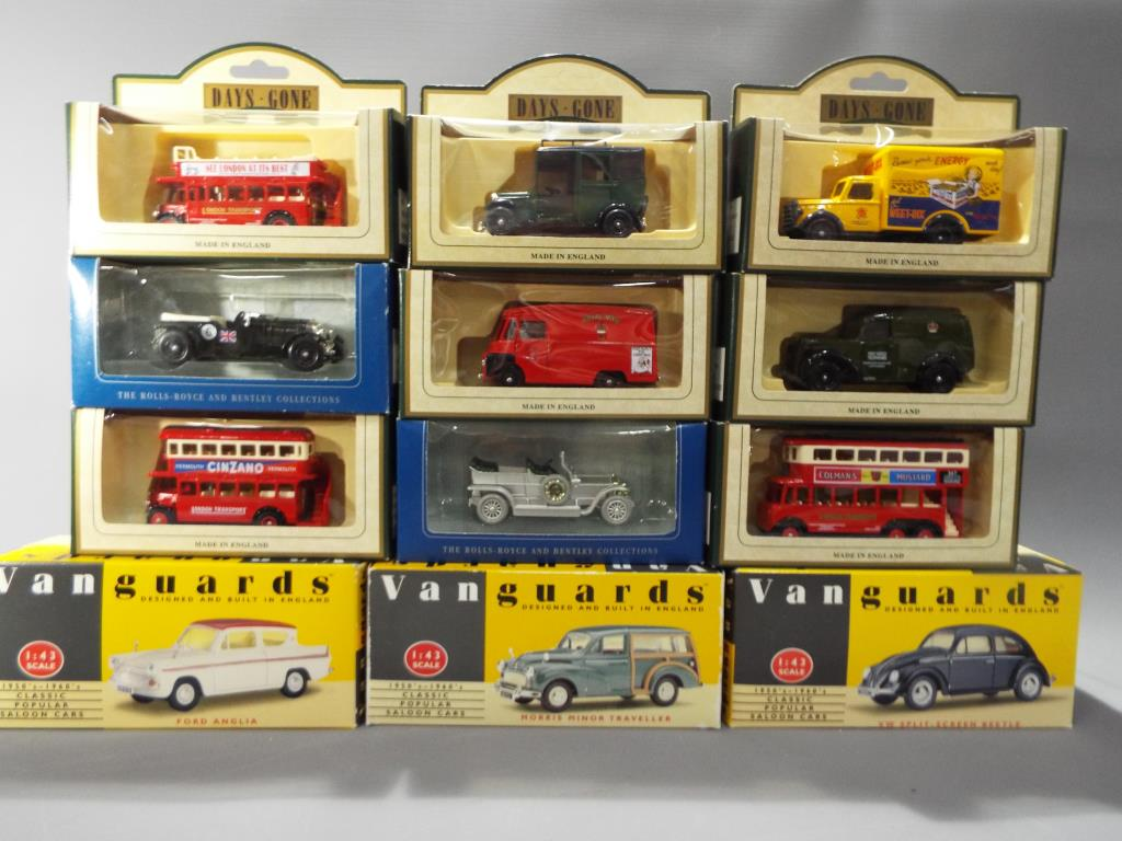 Lot 8 - A small collection of diecast model motor vehicles comprising 3 x Vanguard 1:43 scale and 9 x