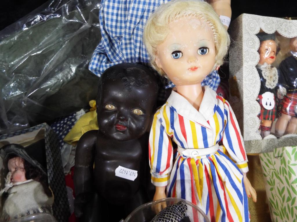Lot 60 - A collection of three mid-century dolls to include a black Marie-Mia doll approximately 5 cm (h),