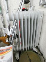Lot 44 - An eight fin electric radiator