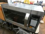 Lot 64 - A stainless steel finish microwave oven