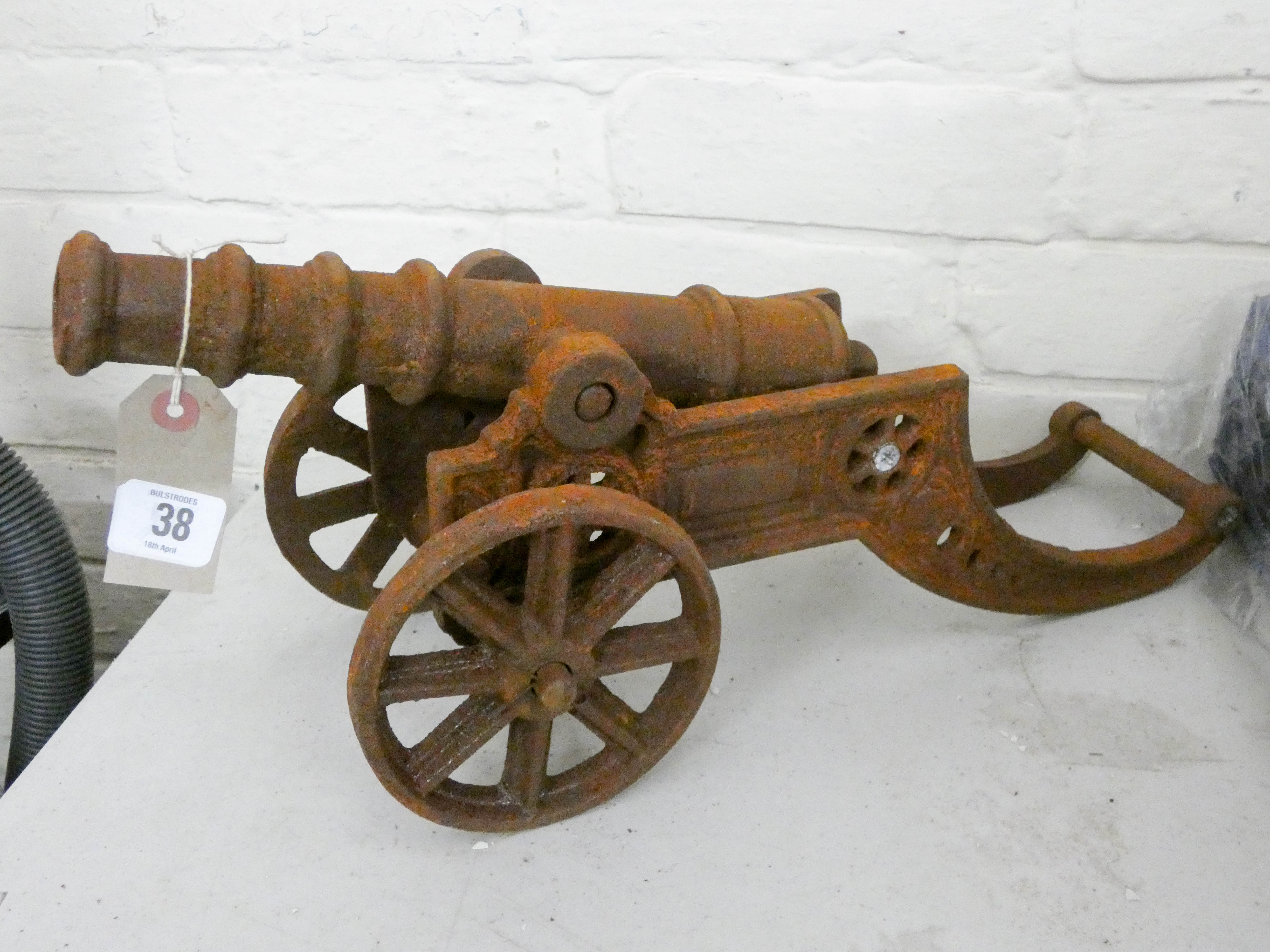 Lot 38 - A small rusty cast iron cannon
