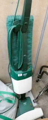 Lot 60 - A Vorwerk upright vacuum cleaner with accessories