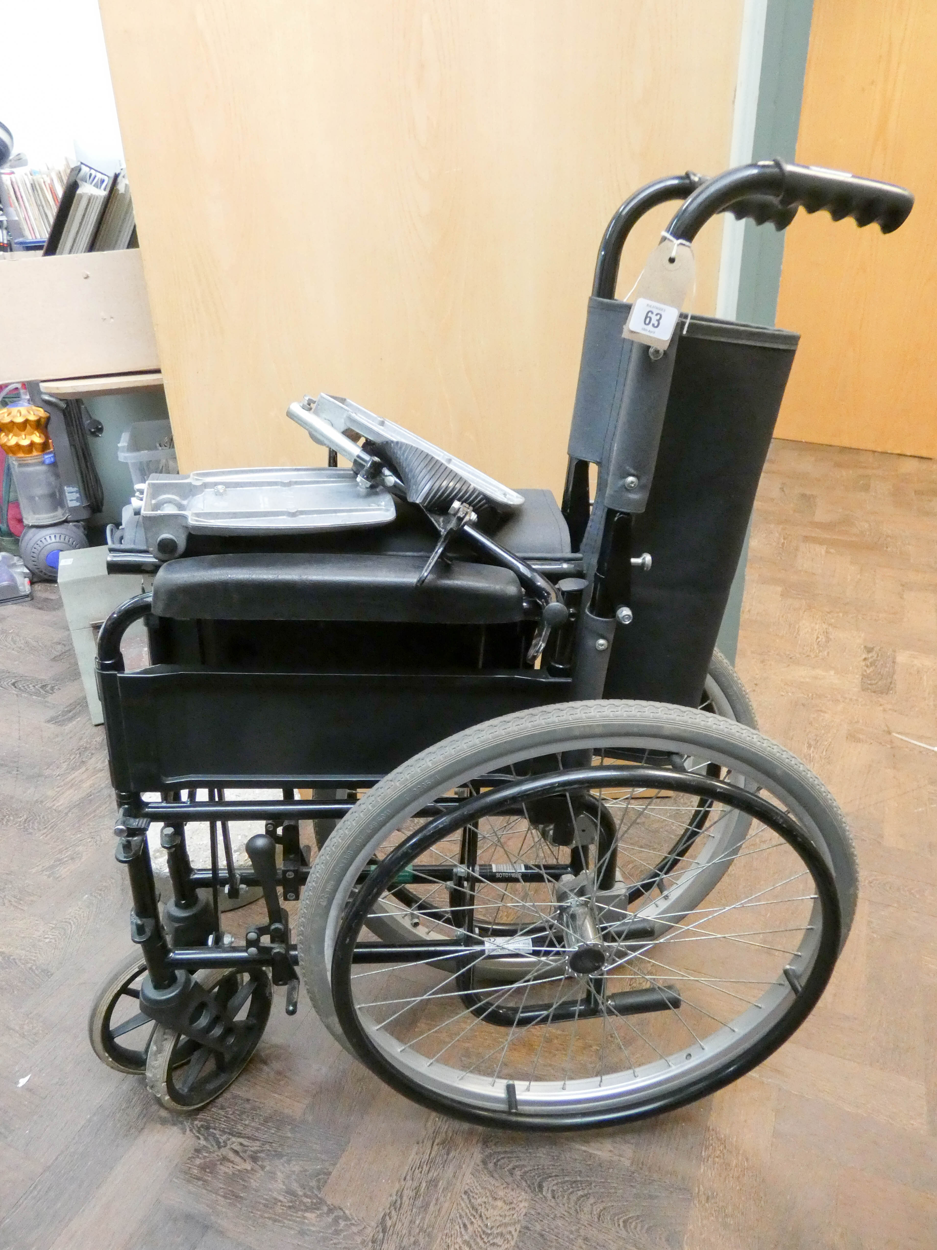 Lot 63 - A fold up self-propelled wheelchair