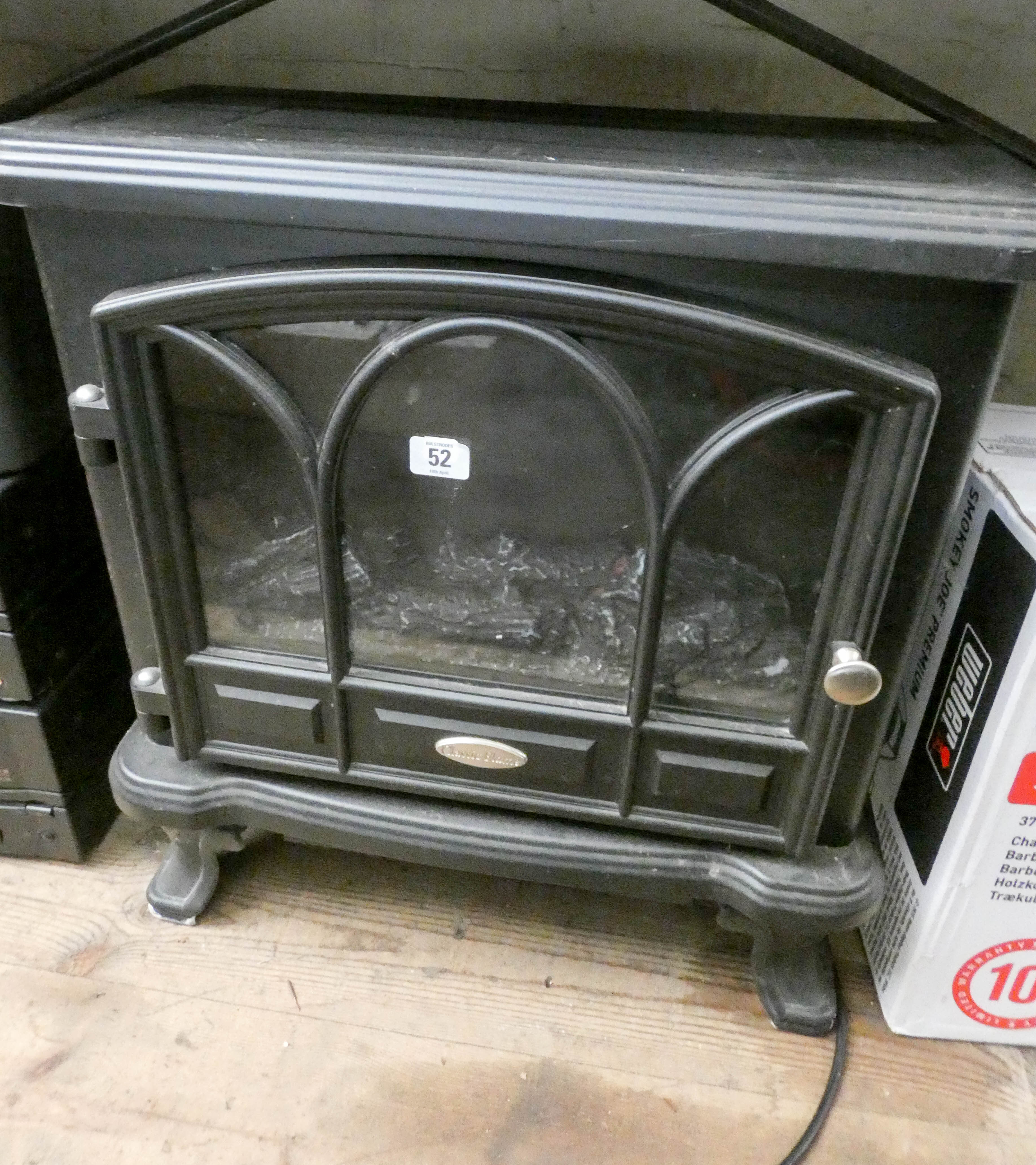 Lot 52 - A low effect style electric heater