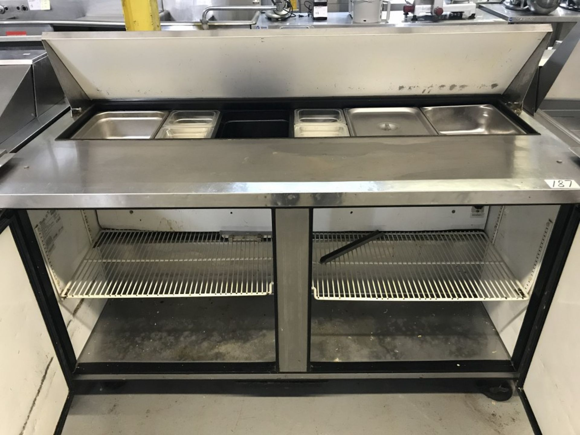 "Lot 5 - TRUE - SOLID 2-DOOR 60"" SALAD/SANDWICH PREP TABLE. MODEL # TSSU-60-16"