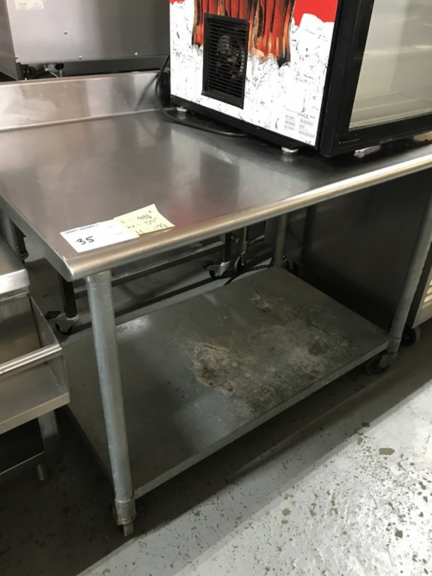 """Lot 35 - STAINLESS STEEL TABLE - 48.5""""L X 30""""W X 39.5""""H"""
