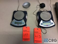 Lot of three assorted Ohaus digital scales, (2) Scout Pro, 200 gram capacity, and one bench top