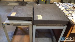 Lot of two assorted granite surface plates, each with stand. One Starrett 18x 24 x 3 inch, and one