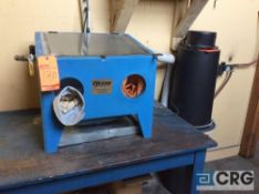 Cyclone bench top sand blast machine, with dust collector, model and serial nos unavailable.