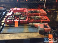 Lot of Milwaukee handtools including (2) sawzalls, (1) portable bandsaw, and (1) HD 1 3/4 inch
