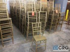 Lot of (60) gold chivari chairs.