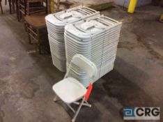 Lot of (53) white folding kids chairs with metal frame and plastic seats.