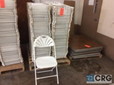 Lot of (100) assorted white, fan back, plastic seat with metal frame, folding chairs.