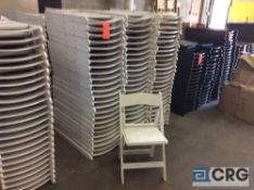 Lot of (150) assorted white resin folding chairs.
