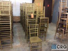 Lot of (59) gold chivari chairs.