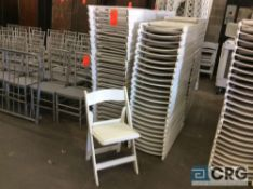 Lot of (100) assorted white resin folding chairs.