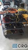 Lot of assorted extension cords and power cords, etc contents of the cart, cart is excluded