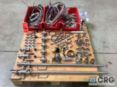 Lot of assorted stainless steel plumbing parts including flex hose, valves, clamps, and