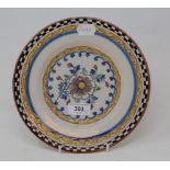 A set of three 19th century Dutch Delft polychrome plates, with floral decoration, 23 cm diameter