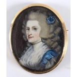 An oval bust portrait miniature, of a lady with ringlets and a blue flower in her hair, watercolour,