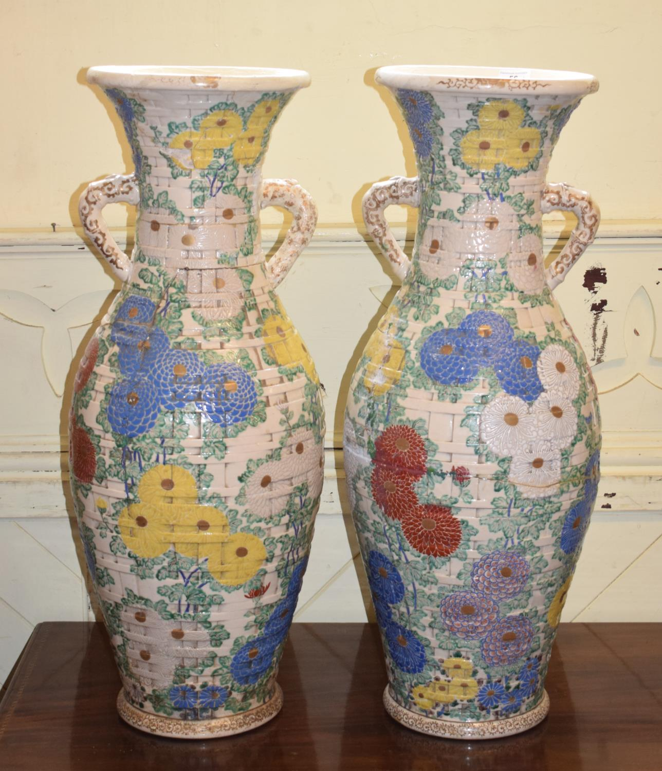 Lot 56 - A large pair of Japanese Satsuma baluster vases, moulded in the form of baskets, decorated flowers
