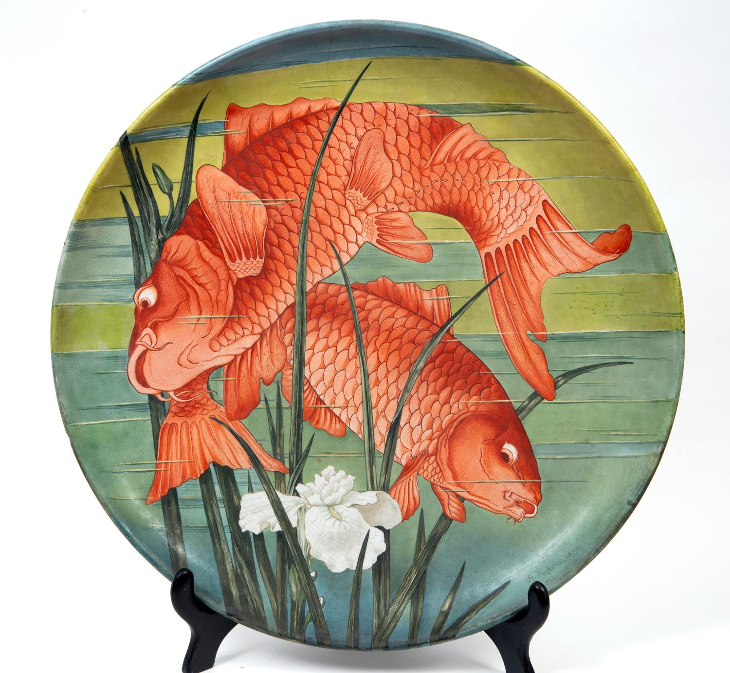 Lot 16 - A large Minton pottery plate, decorated a pair of carp by H Ryland, signed and dated 1880,