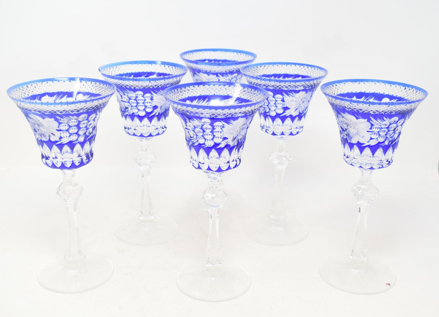 Lot 18 - A set of six hock glasses, with etched decoration, one chipped, 21.5 cm high, a Waterford cut