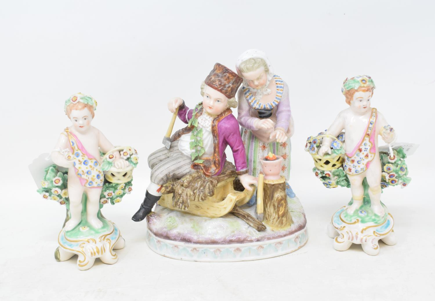 Lot 58 - A Meissen style porcelain group, in the form of a boy wearing a fur hat holding an axe, seated on