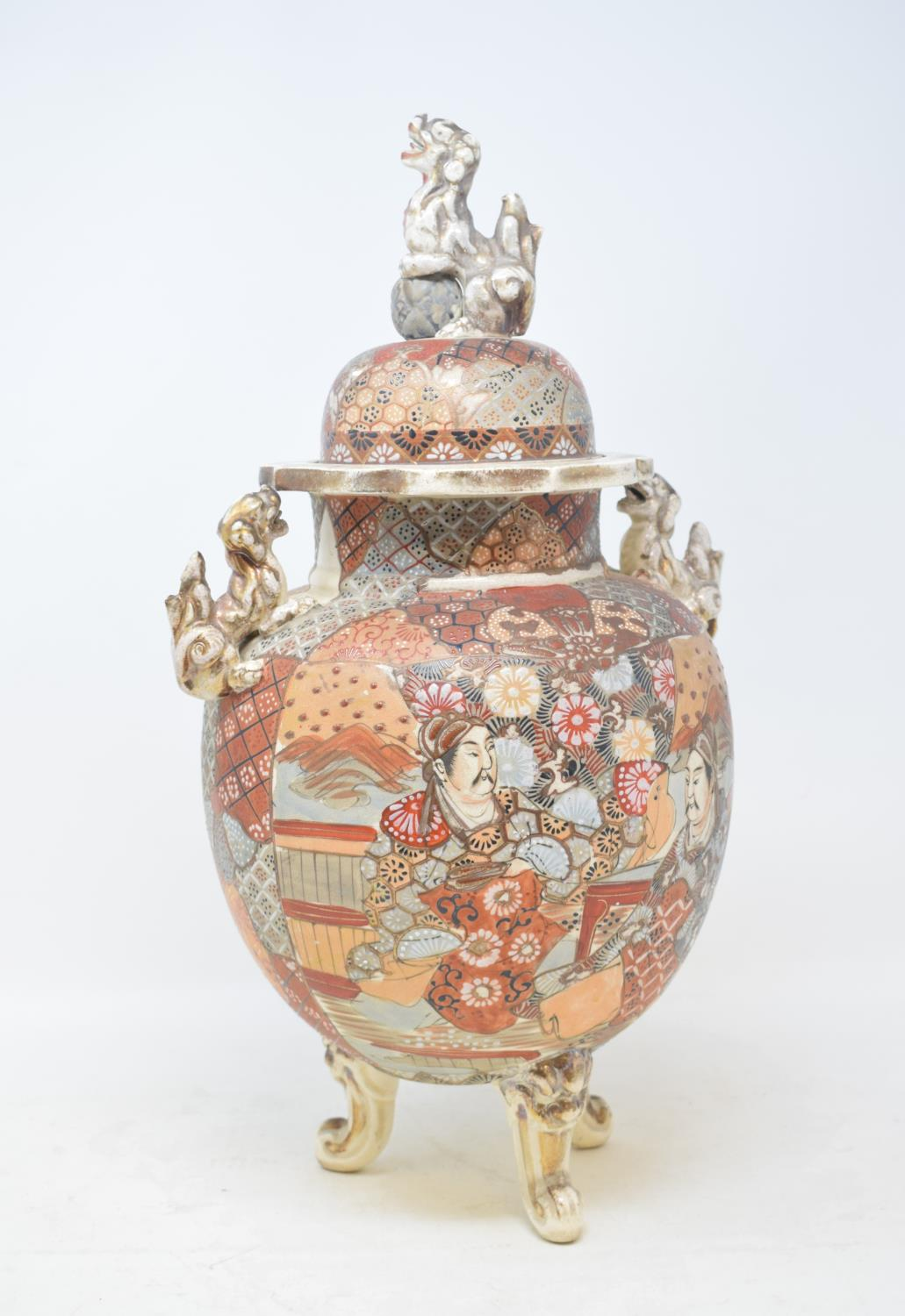 Lot 14 - A Japanese Satsuma vase and cover, decorated figures, with a Dog of Fo finial, 40 cm high, and three