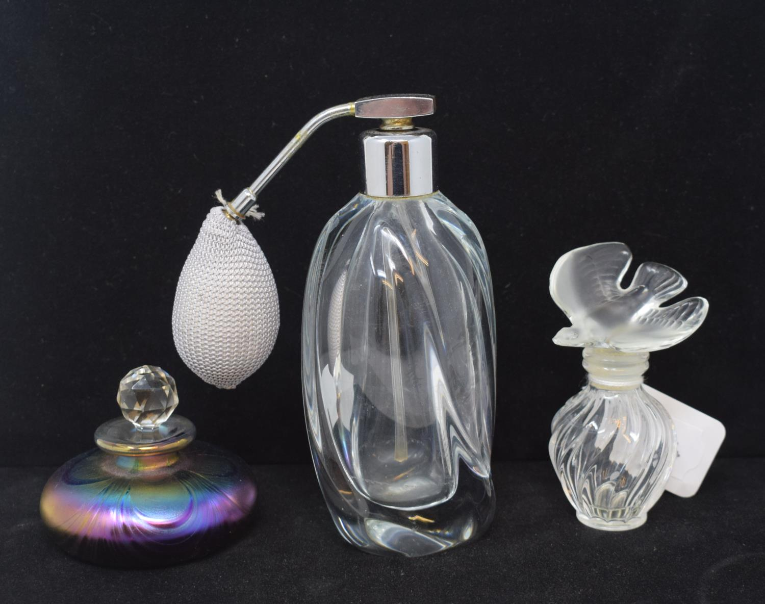 Lot 60 - A Lalique frosted and clear glass scent bottle, the stopper in the form of a dove, 10 cm high, and