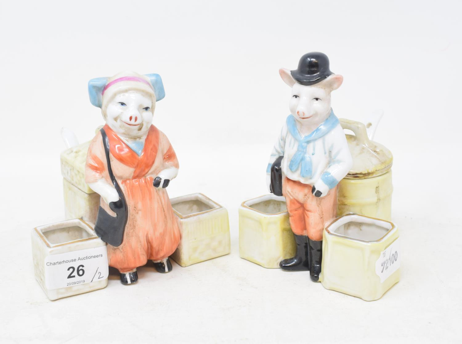 Lot 26 - A pair of novelty pig condiments, 11 cm wide (2) Modern