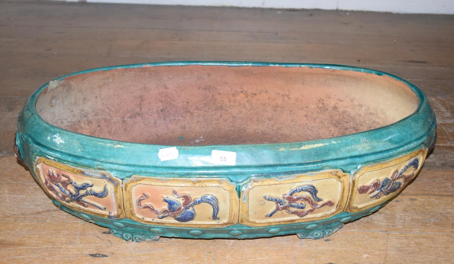 Lot 55 - A Chinese earthenware jardiniere, of rounded rectangular form, decorated various motifs, 78 cm