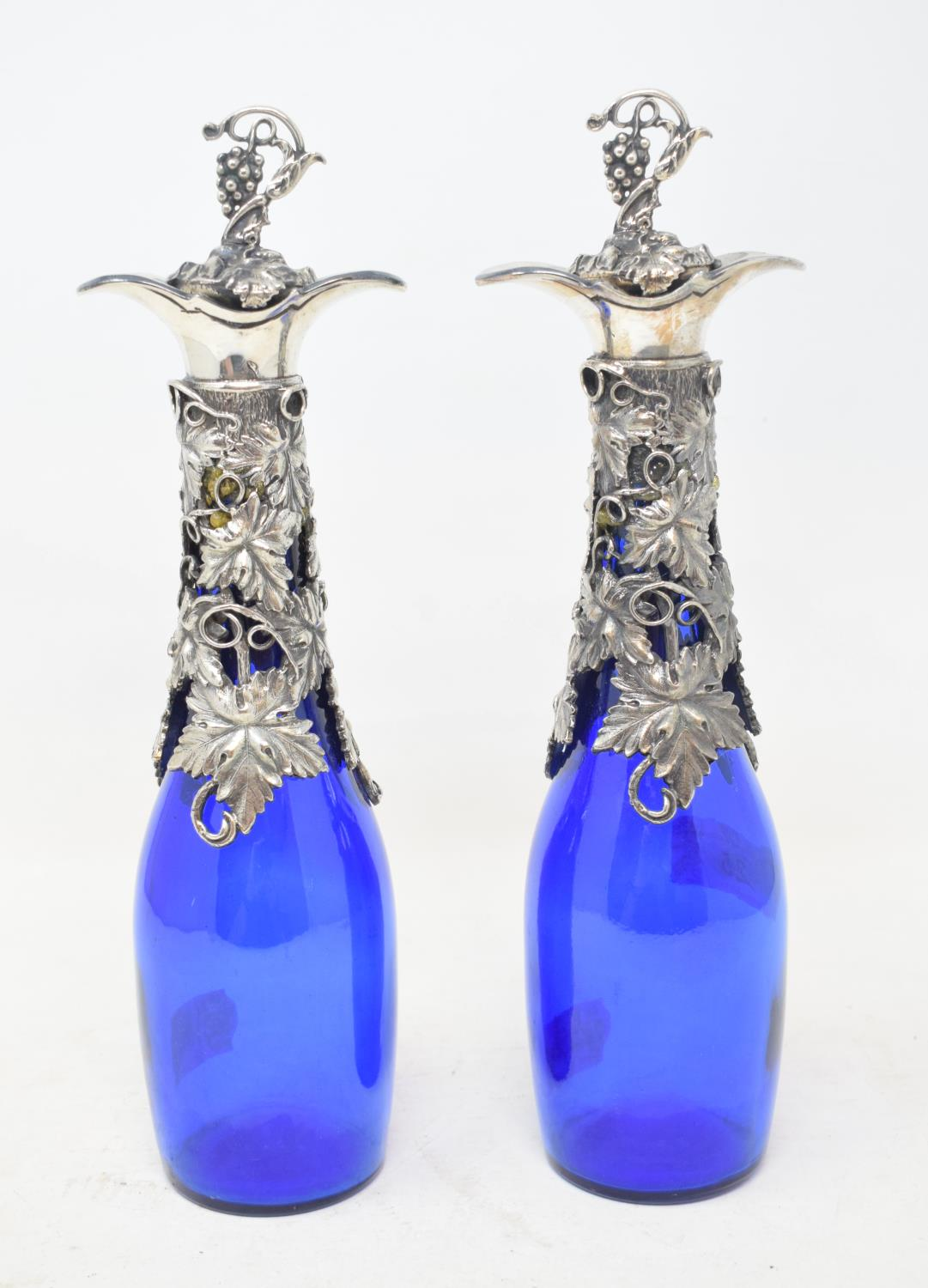 Lot 25 - A pair of blue glass decanters, with plated mounts, 16.5 cm high (2) Modern
