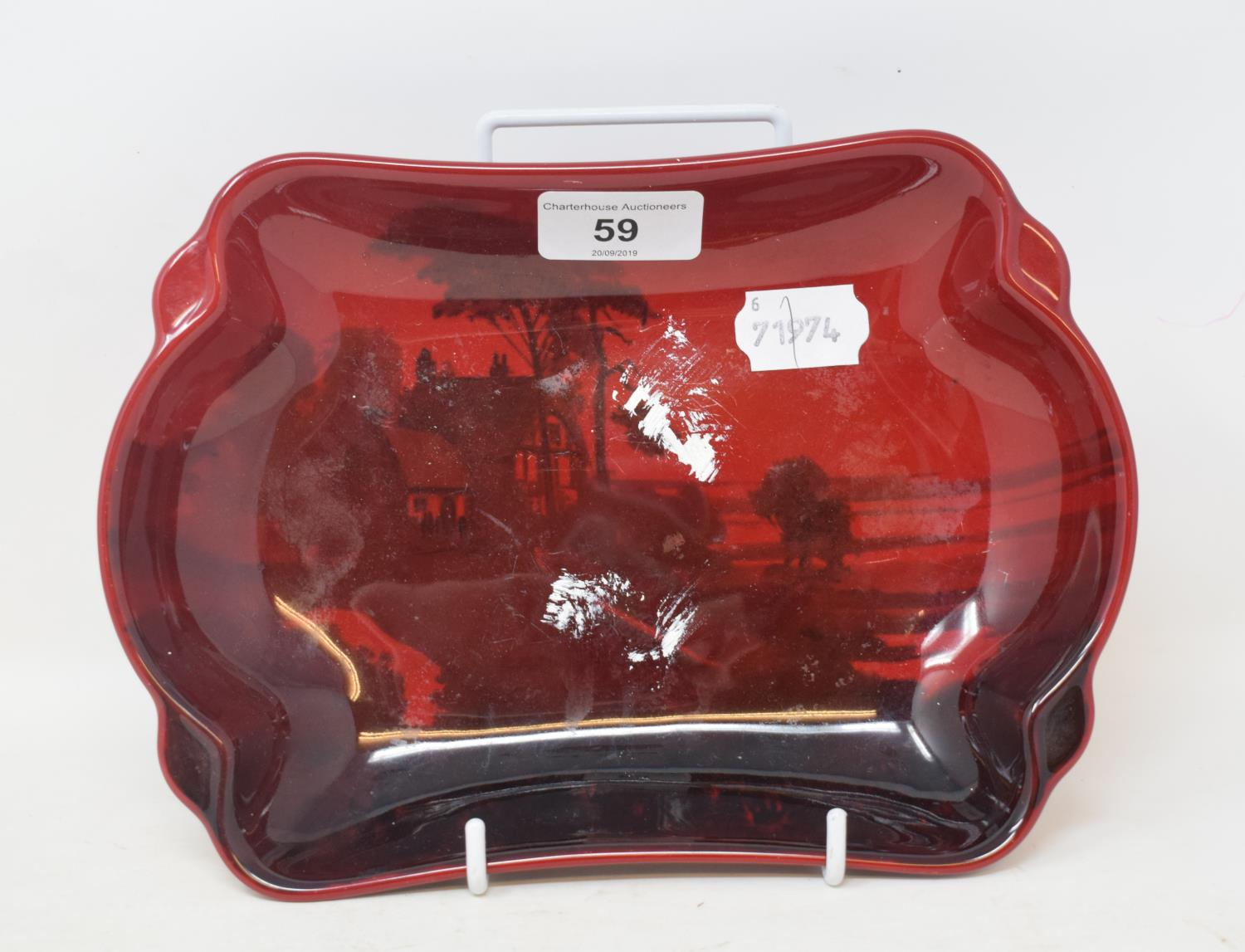 Lot 59 - A Royal Doulton Flambe dish, decorated a farmhouse scene, 8808, signed Noke to base, 23 cm wide