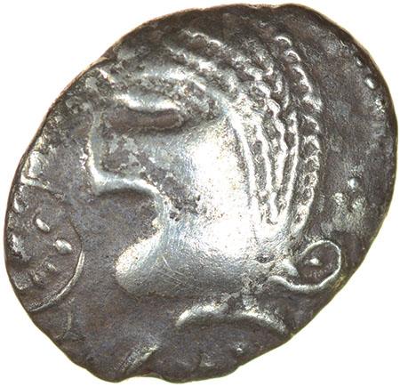 Lot 11 - Mossop Proto Head. Talbot Large Flan A, dies F/12.c.50-40 BC. Celtic silver unit. 13-16mm. 1.27g.