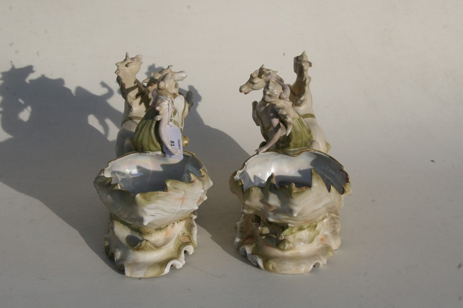 Lot 81 - A pair of Royal Dux style Art Nouveau porcelain baskets in the form of a maiden being pulled along