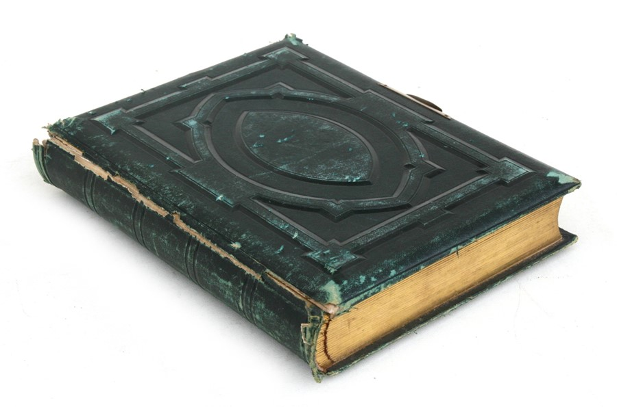 Lot 113 - A Victorian green leather photograph album containing mainly family portraits.