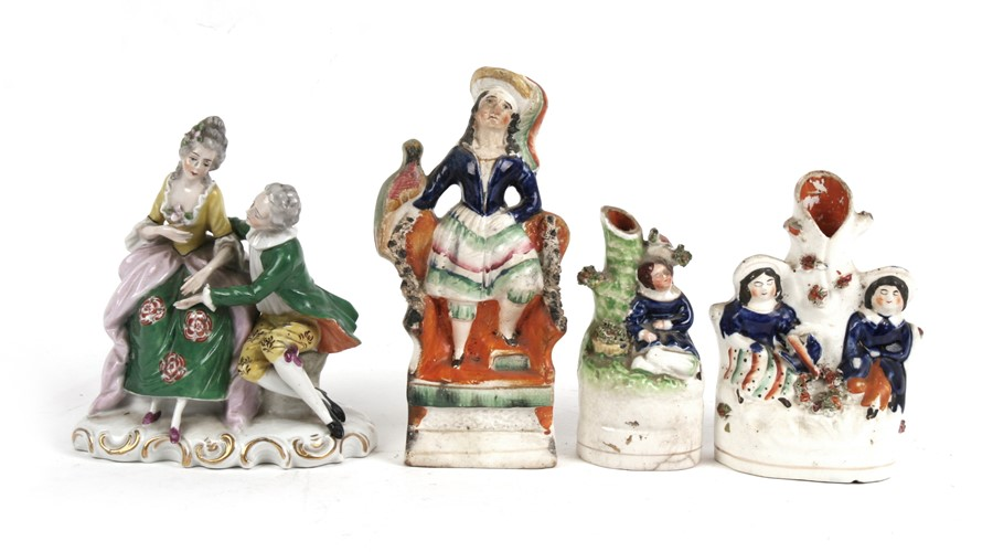 Lot 52 - Three 19th century Staffordshire pottery groups; together with a continental porcelain group, the