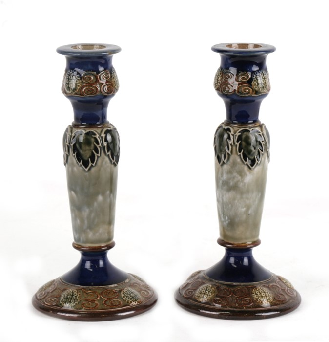 Lot 21 - A pair of Royal Doulton Stoneware candlesticks, 19cms (7.5ins) high.Condition Report Good