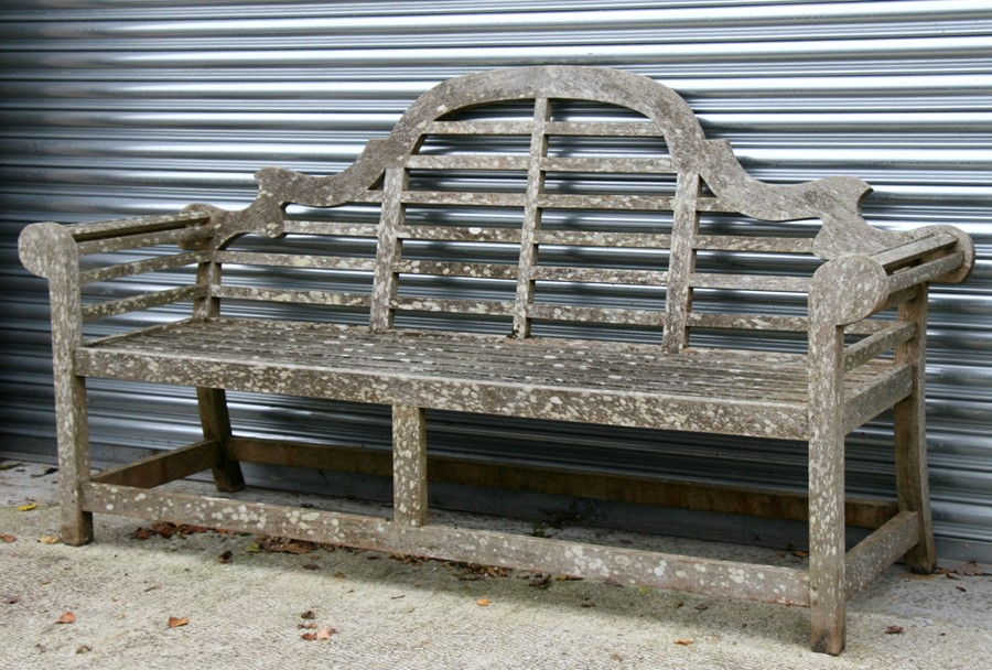 Lot 3 - A large well weathered teak Lutyens style garden bench, 196cms (77ins) wide.