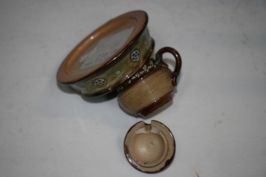 Lot 24 - A Royal Doulton Stoneware salt and pepper; together with a two-handled jug; a mustard pot; a chamber