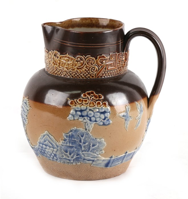 Lot 39 - A Doulton Stoneware jug decorated with a Chinese landscape scene, 16cms (6.25ins) high.