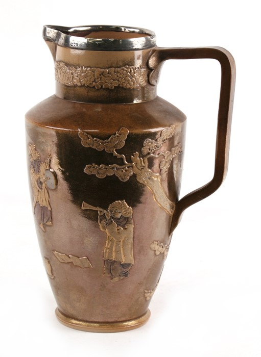 Lot 20 - A Victorian Doulton Lambeth Stoneware lustre silver mounted jug decorated with Chinese figures,