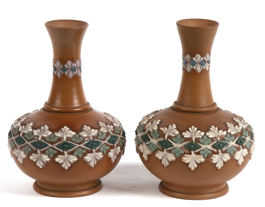 Lot 36 - A pair of Doulton Silicon vases decorated with flowers, 11cms (4.25ins) high.