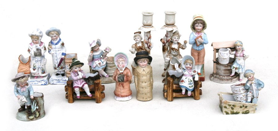 Lot 79 - A quantity of 19th century fairing match strikers; together with a pair of figural salt and pepper