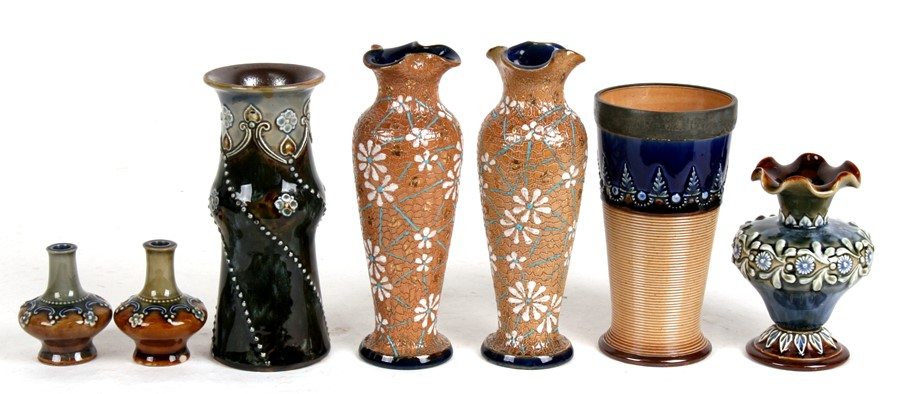 Lot 58 - A pair of Royal Doulton stoneware vases, 17cms (6.5ins) high; together with a pewter mounted Royal